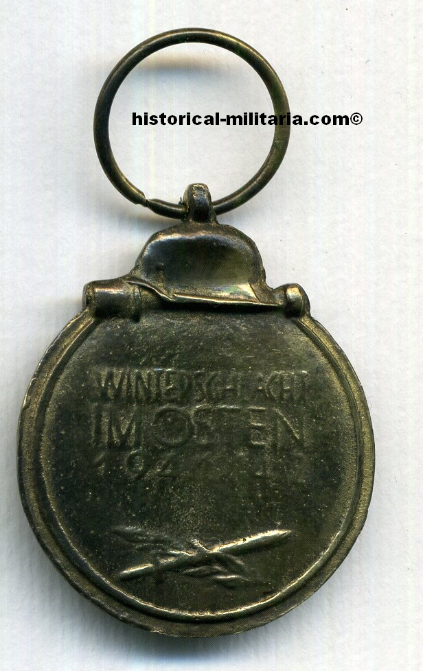 Orden WINTERSCHLACHT IM OSTEN 1941/1942 gealtert am 20cm Band / German Eastern Front Medal aged with 20cm ribbon / MEDAGLIA PER LA CAMPAGNA D'INVERNO 1941-42 in Russia con nastro